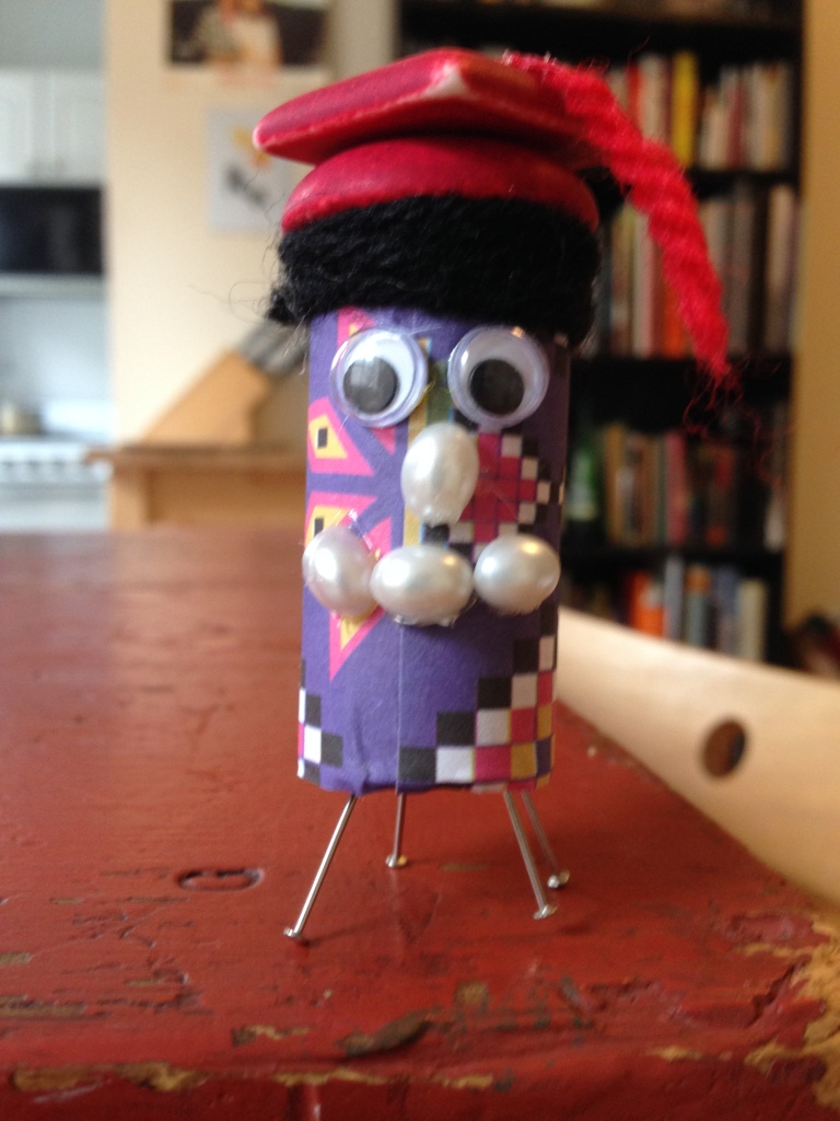 The minion I made from a cork, some paper, beads, and yarn.