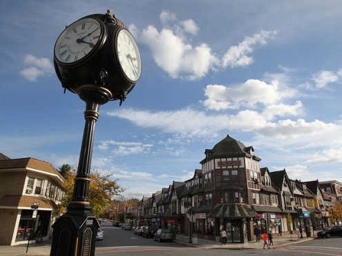 The borough of Swarthmore, home of the college and a quaint town center. The town center where Chester Rd., right, and Park Ave intersect is shown with the clock at the Swarthmore SEPTA station on Nov. 5, 2013. ( CHARLES FOX / Staff Photographer )